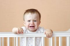 Name:  crying-baby-white-bed-age-months-33871124.jpg